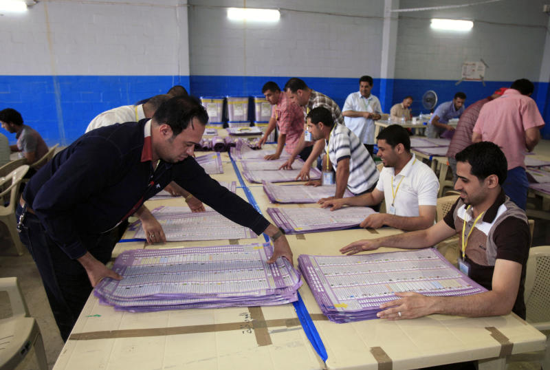 Electoral workers count ballots at a counting center in Baghdad, Iraq, Wednesday, April 24, 2013. Iraqis have begun counting votes from the first provincial elections since the last U.S. troops withdrew in December 2011. (AP Photo/ Karim Kadim)