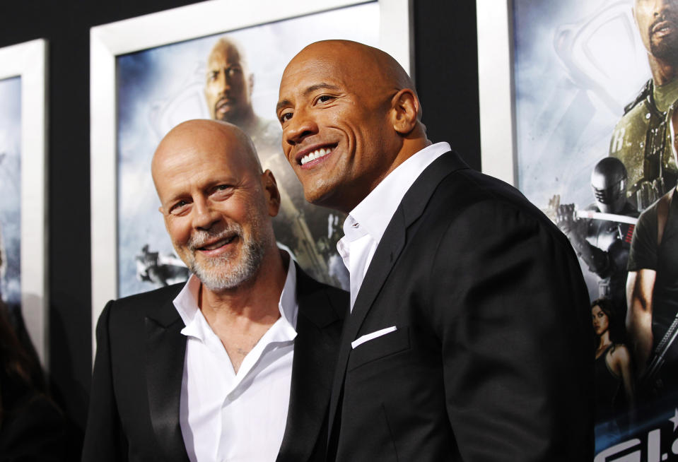 """Cast members Dwayne Johnson (R) and Bruce Willis pose at the premiere of """"G.I. Joe: Retaliation"""" in Hollywood, California March 28, 2013. The movie opens in the U.S. on March 28. REUTERS/Mario Anzuoni (UNITED STATES - Tags: ENTERTAINMENT)"""