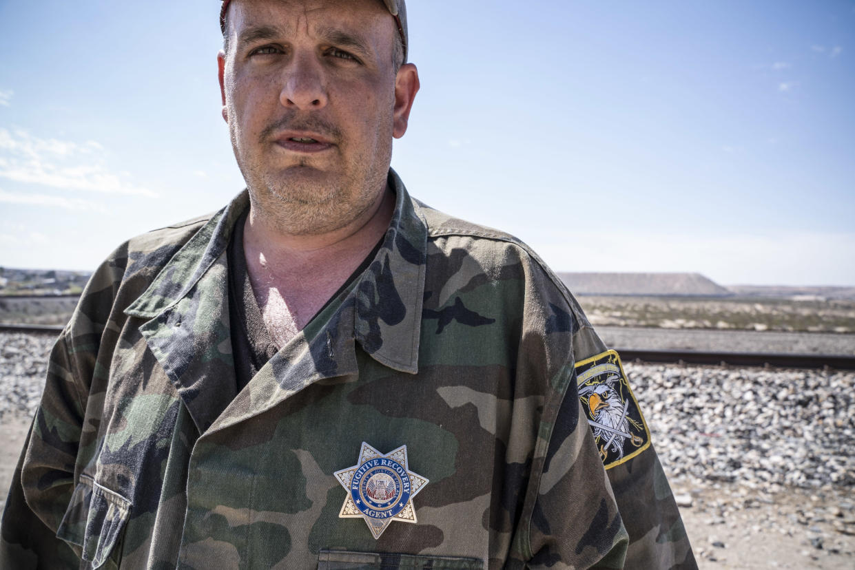 United Constitutional Patriots member Jim Benvie near the border wall in Anapra, N.M., in March. (Photo: Pail Ratje/AFP/Getty Images)