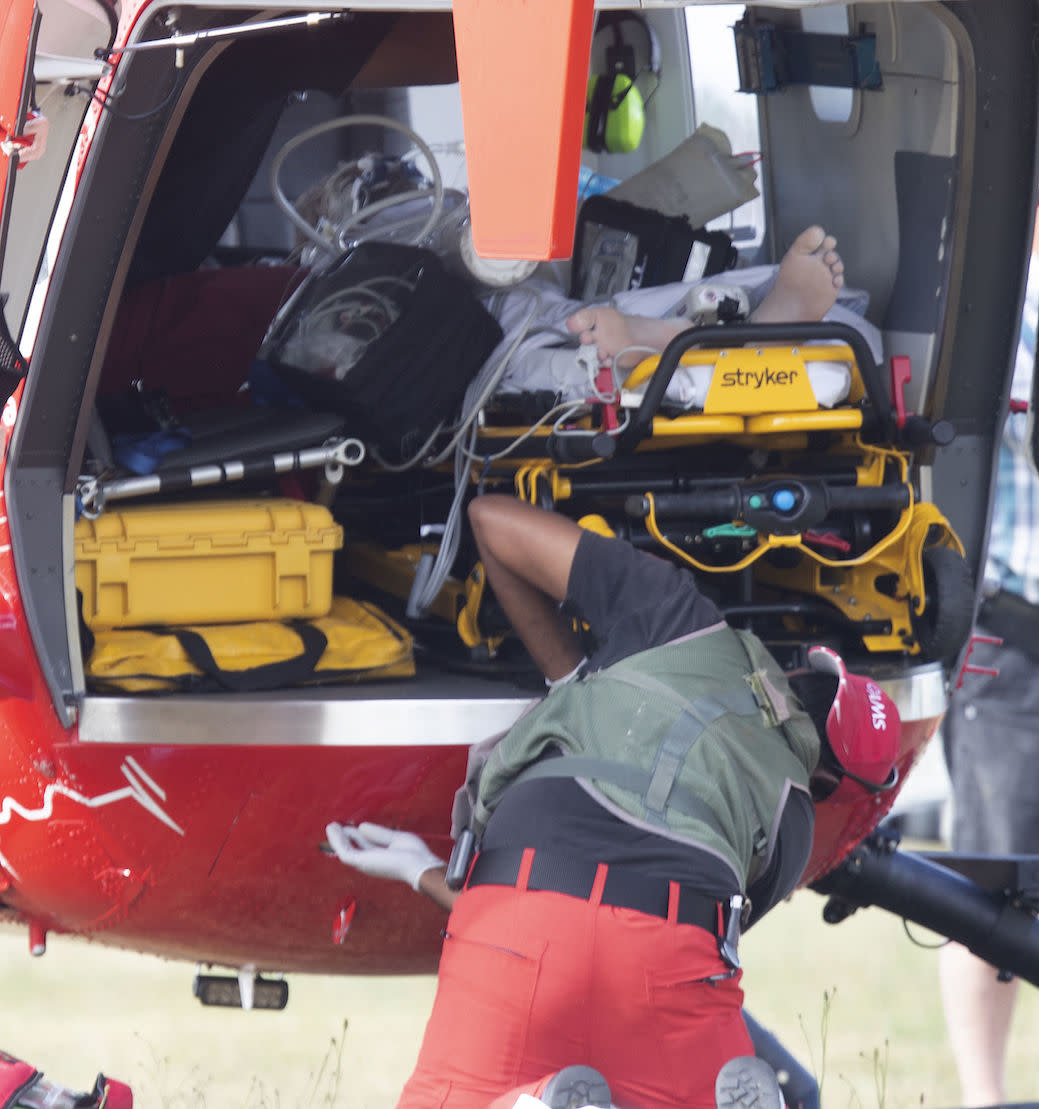 Emergency services attend to an injured person arriving at the Whakatane Airfield after the volcanic eruption (Picture: AP)