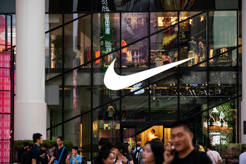 SHANGHAI, CHINA - 2019/07/17: An American multinational sportswear corporation Nike logo seen in Shanghai with pedestrians walking past it. (Photo by Alex Tai/SOPA Images/LightRocket via Getty Images)