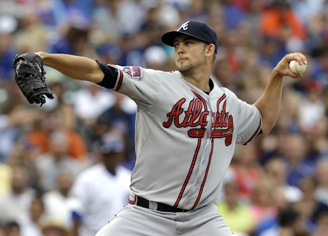 Atlanta Braves starter Mike Minor throws against the Chicago Cubs during the first inning of a baseball game in Chicago, Saturday, July 12, 2014. (AP Photo/Nam Y. Huh)