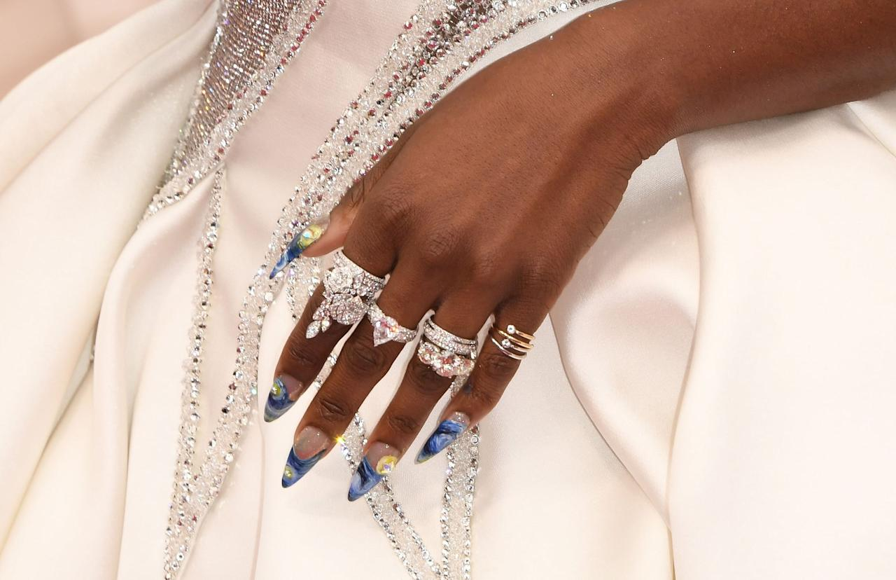 """<p>Erivo's <a href=""""https://www.popsugar.com/beauty/cynthia-erivo-nail-art-oscars-2020-47197071"""" class=""""ga-track"""" data-ga-category=""""Related"""" data-ga-label=""""https://www.popsugar.com/beauty/cynthia-erivo-nail-art-oscars-2020-47197071"""" data-ga-action=""""In-Line Links"""">blue-tipped french manicure</a> featured so much more than meets the eye. As her manicurist <a href=""""https://www.instagram.com/ohriginails/"""" target=""""_blank"""" class=""""ga-track"""" data-ga-category=""""Related"""" data-ga-label=""""https://www.instagram.com/ohriginails/"""" data-ga-action=""""In-Line Links"""">Gina Oh</a> explained, one hand included a trendy design of Vincent Van Gogh's classic """"The Starry Night,"""" while the other featured an ode to Harriet Tubman and the North Star. </p>"""