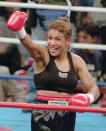 FILE - In this Sept. 13, 1997, file photo, Lucia Rijker, of the Netherlands, gestures after beating Andrea Deshong in a boxing match in Las Vegas. Rijker was elected to the International Boxing Hall of Fame, Wednesday, Dec. 4, 2019. (AP Photo/Lennox McLendon, File)