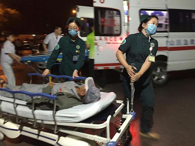 <p>Medical workers transport a person injured in an explosion outside a kindergarten into a hospital in Fengxian County in eastern China's Jiangsu Province early Friday, June 16, 2017. (Photo: Li Xiang/Xinhua via AP) </p>