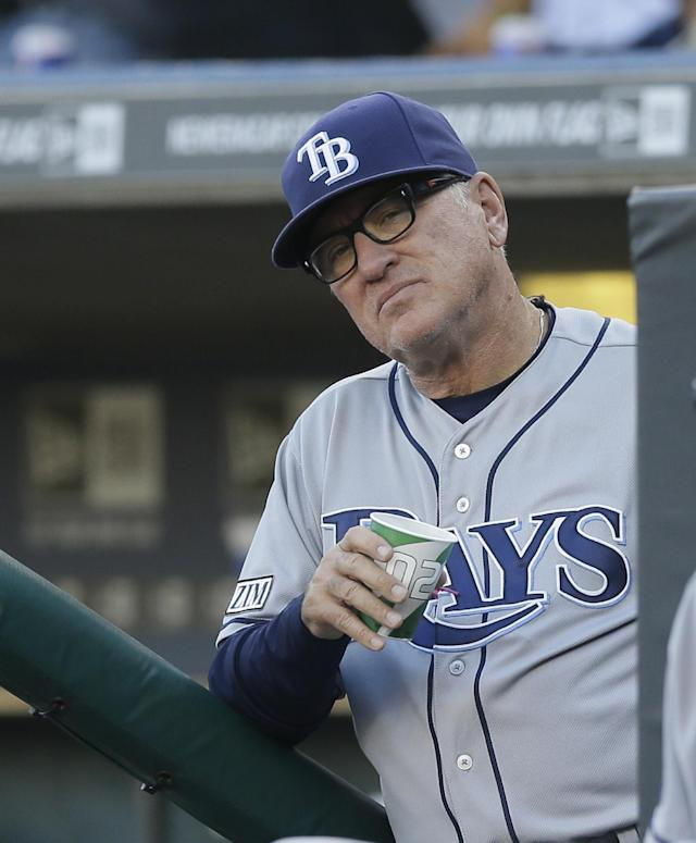 Tampa Bay Rays manager Joe Maddon looks from the dugout during the first inning of a baseball game against the Detroit Tigers in Detroit, Thursday, July 3, 2014. (AP Photo/Carlos Osorio)