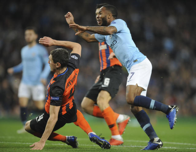 Manchester City midfielder Raheem Sterling, right, scores his side's third goal during the Champions League Group F soccer match between Manchester City and Shakhtar Donetsk at Etihad stadium in Manchester, England, Wednesday, Nov. 7, 2018. (AP Photo/Rui Vieira)