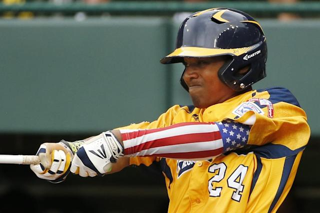 Chicago's Trey Hondras (24) hits a two-run home run off Las Vegas pitcher Brennan Holligan in the first inning of the United States Championship game at the Little League World Series in South Williamsport, Pa., Saturday, Aug. 23, 2014. (AP Photo/Gene J. Puskar