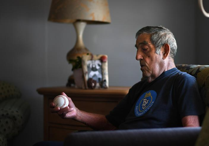 """That was my life. We never missed a Sunday of baseball,"" said Art Velarde, shown in his Hacienda Heights home. He played eight years as a catcher for Carmelita. <span class=""copyright"">(Wally Skalij / Los Angeles Times)</span>"
