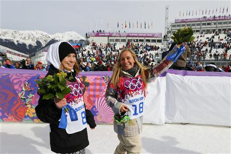 Second placed Finland's Enni Rukajarvi (L) and winner Jamie Anderson of the U.S. celebrate after competing in the women's snowboard slopestyle finals event at the 2014 Sochi Winter Olympics in Rosa Khutor, February 9, 2014. REUTERS/Mike Blake