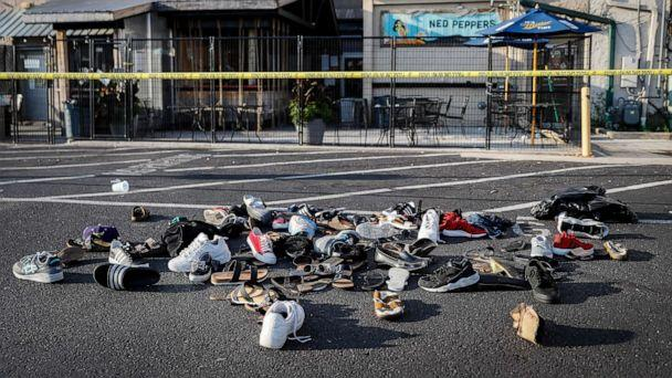 PHOTO: Shoes are piled outside the scene of a mass shooting including Ned Peppers bar, Aug. 4, 2019, in Dayton, Ohio. Several people in Ohio have been killed in the second mass shooting in the U.S. in less than 24 hours. (John Minchillo/AP)