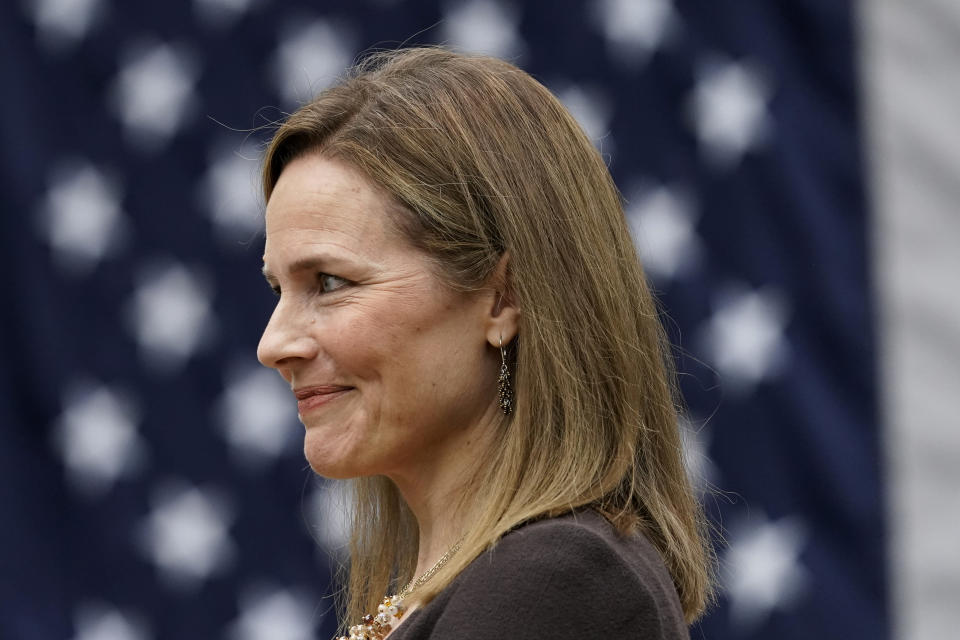 Judge Amy Coney Barrett listens as President Donald Trump announces Barrett as his nominee to the Supreme Court, in the Rose Garden at the White House, Saturday, Sept. 26, 2020, in Washington. (AP Photo/Alex Brandon)