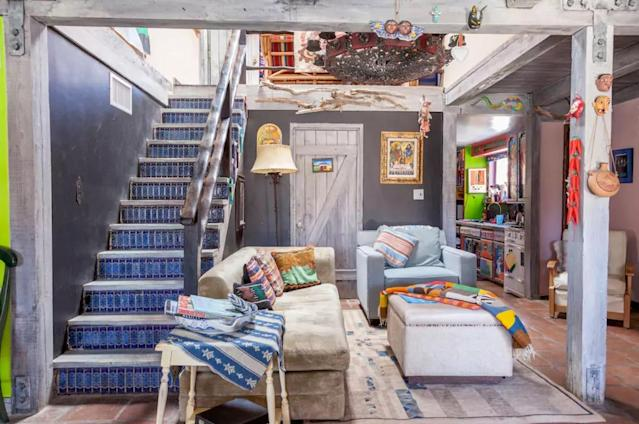 <p>The interior features no shortage of birght colours and interesting pieces to spend the days examining.<br>(Airbnb) </p>