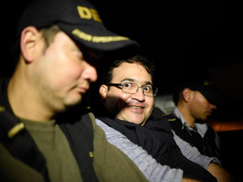 Former Veracruz governor Javier Duarte with officers in Guatemala after six months on the run: Getty Images/AFP