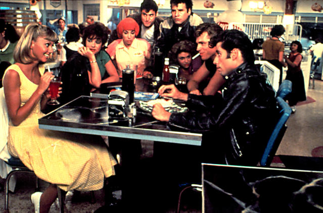 The cast of <em>Grease</em> in the diner scene: from left, Olivia Newton-John, Stockard Channing, Didi Conn, Barry Pearl, Michael Tucci, Dinah Manoff, Jeff Conaway, and John Travolta. (Photo: Courtesy of Paramount c/o the Everett Collection)