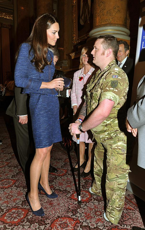 Duchess Catherine, who donned a tweed Rebecca Taylor suit, sipped on water and mingled with a member of the military.