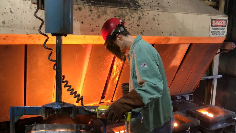 A worker pours hot metal at the Kirsh Foundry in Beaver Dam