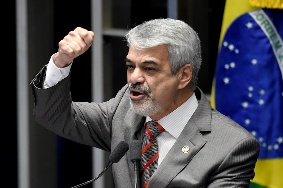 Brazilian senator Humberto Costa, from the ruling Workers Party (PT), speaks during a senate's session to form a committee that will consider whether to impeach president Dilma Rousseff, in Brasilia, on April 25, 2016. Brazil's Senate met Monday to form a committee that will consider whether to impeach Rousseff, who has accused her opponents of mounting a constitutional coup. She is accused of illegal government accounting maneuvers, but says she has not committed an impeachment-worthy crime. The Senate committee -- comprising 21 of the 81 senators -- was to debate Rousseff's fate for up to 10 working days before making a recommendation to the full upper house.  / AFP / EVARISTO SA        (Photo credit should read EVARISTO SA/AFP via Getty Images)