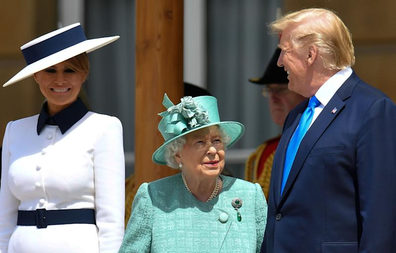 Britain's Queen Elizabeth II (C) speaks with US President Donald Trump (R) as US First Lady Melania Trump (L) smiles during a welcome ceremony at Buckingham Palace in central London on June 3, 2019, on the first day of the US president and First Lady's three-day State Visit to the UK. (Photo: Toby Melville / Pool / AFP/Getty Images)