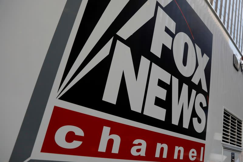 FILE PHOTO: FILE PHOTO: A Fox News channel sign is seen on a television vehicle outside the News Corporation building in New York City, in New York