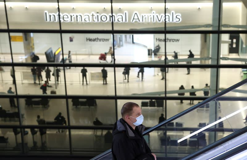 A person goes up an escalator at Terminal 2 of Heathrow Airport, amid the coronavirus disease (COVID-19) outbreak in London