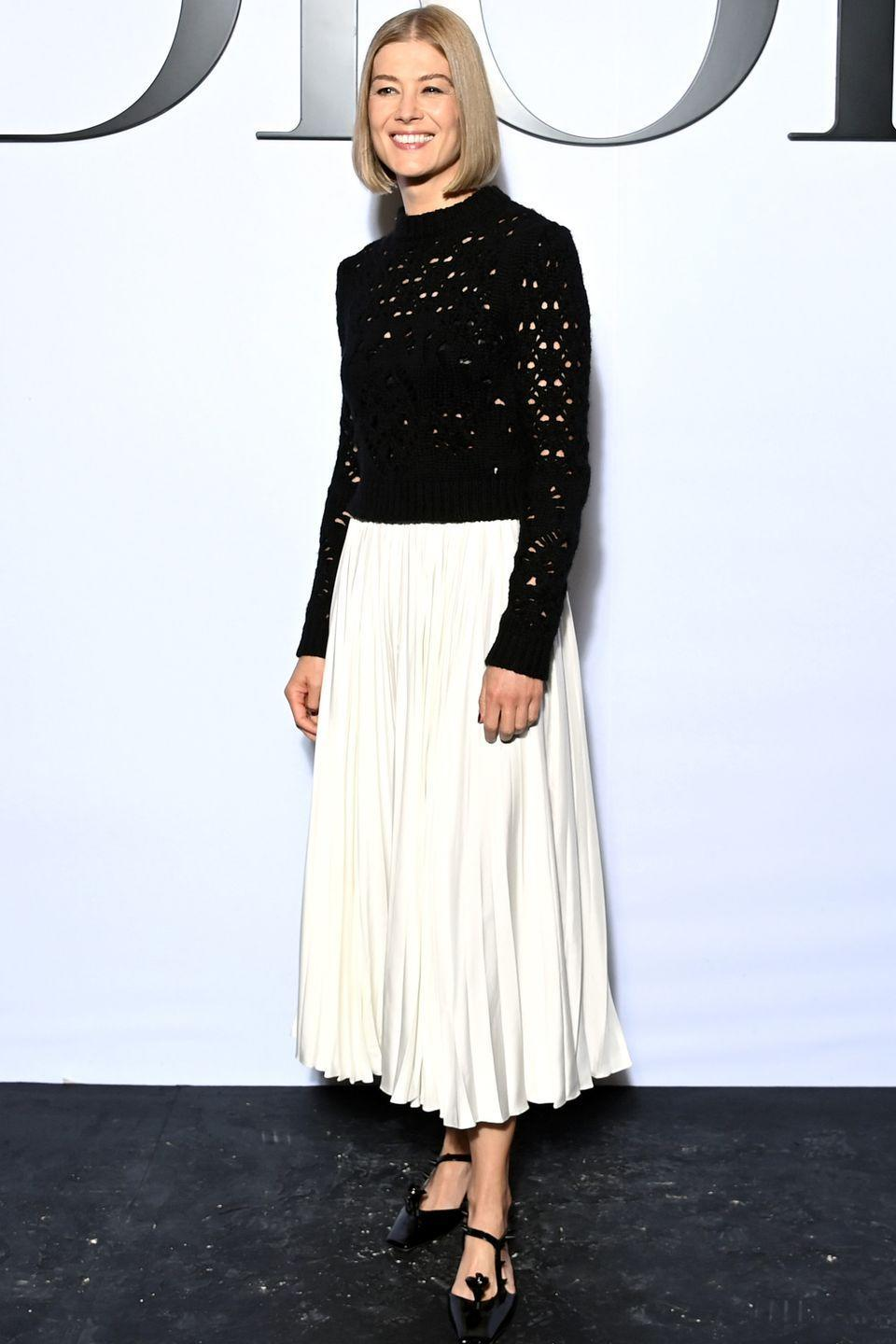 <p><strong>28 September </strong></p><p>Rosamund Pike was one of many celebrities to attend the Dior spring/summer 2022 show during Paris Fashion Week, wearing a ladylike pleated skirt. </p>