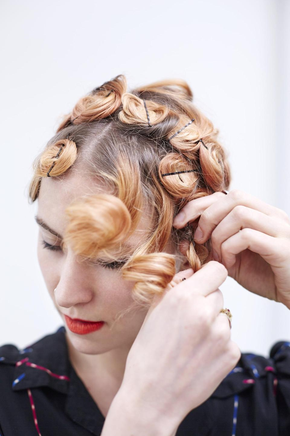 <p>Once dry, gently pull out all the bobby pins.</p>