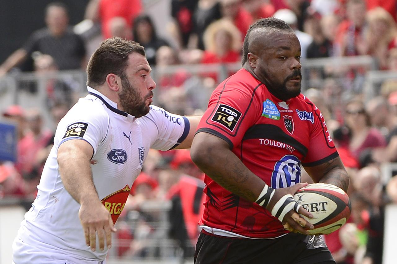 RC Toulon's French centre Mathieu Bastareaud (R) vies with Agen's Laurent Cabarry (L) during the French Top 14 rugby Union match RC Toulon vs Agen on May 4, 2013, at the Mayol stadium in Toulon. AFP PHOTO / BORIS HORVATBORIS HORVAT/AFP/Getty Images