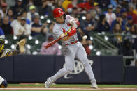 St. Louis Cardinals left fielder Tyler O'Neill hits a two-run home run against the Milwaukee Brewers during the first inning of a baseball game Wednesday, Sept. 22, 2021, in Milwaukee. (AP Photo/Jeffrey Phelps)