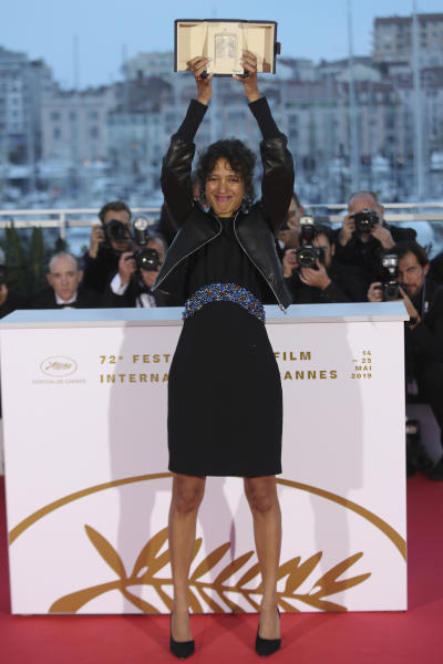 Director Mati Diop, winner of the grand prix Palme d'Or award for the film 'Atlantique' poses for photographers during a photo call following the awards ceremony at the 72nd international film festival, Cannes, southern France, Saturday, May 25, 2019. (AP Photo/Petros Giannakouris)