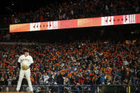 Fans cheer as San Francisco Giants pitcher Logan Webb stands on the mound during the seventh inning of Game 1 of a baseball National League Division Series against the Los Angeles Dodgers Friday, Oct. 8, 2021, in San Francisco. (AP Photo/John Hefti)