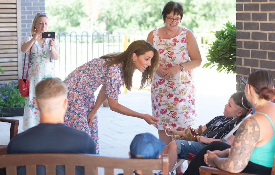 EMBARGOED: No onward transmission before 2100 BST Sat 27/6/2020. Not for publication before 2200 BST Sat 27/6/2020. The Duchess of Cambridge meets Sonny Saunders and his family, including mother Kelly (right, back to camera) and father Jordan (left, back to camera) during a visit to The Nook in Framlingham Earl, Norfolk, which is one of the three East Anglia Children's Hospices (EACH). Sonny was diagnosed with a diffuse intrinsic pontine glioma, an aggressive and difficult-to-treat brain tumour, only a week or so after his sixth birthday in February.