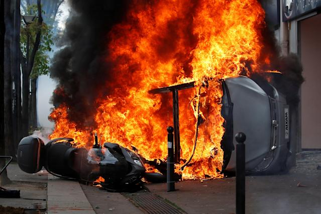 <p>A car burns outside a Renault automobile garage during clashes at the May Day labour union march in Paris, France, May 1, 2018. (Photo: Christian Hartmann/Reuters) </p>