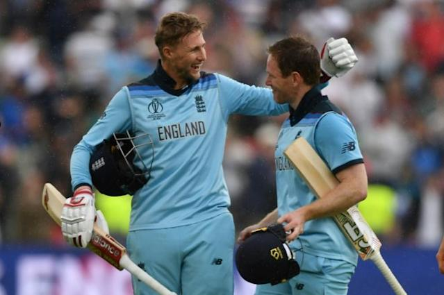 England captain Eoin Morgan (right) and Joe Root celebrate victory in the World Cup semi-final against Australia (AFP Photo/Paul ELLIS)