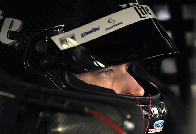 Sprint Cup driver Brad Keselowski waits in his car for the first round of practice to start for a NASCAR auto race at Martinsville Speedway in Martinsville, Va., Friday March 28, 2014. (AP Photo/Mike McCarn)
