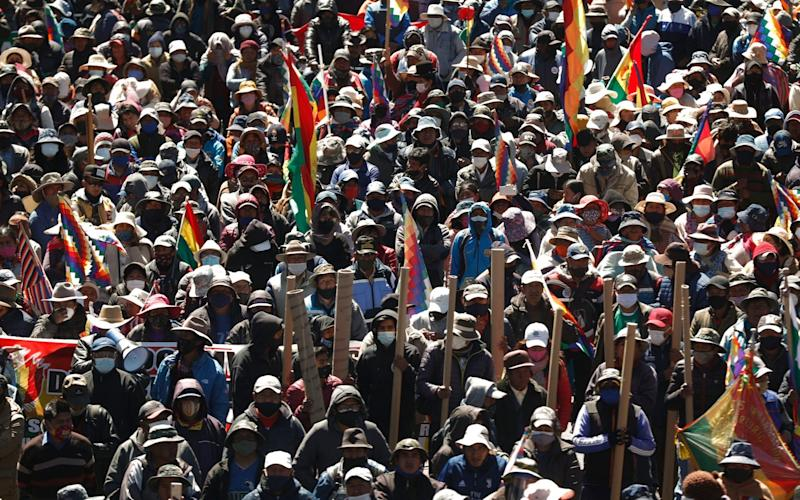 Those who object to the recent postponement of elections take part in a protest in El Alto, Bolivia - AP