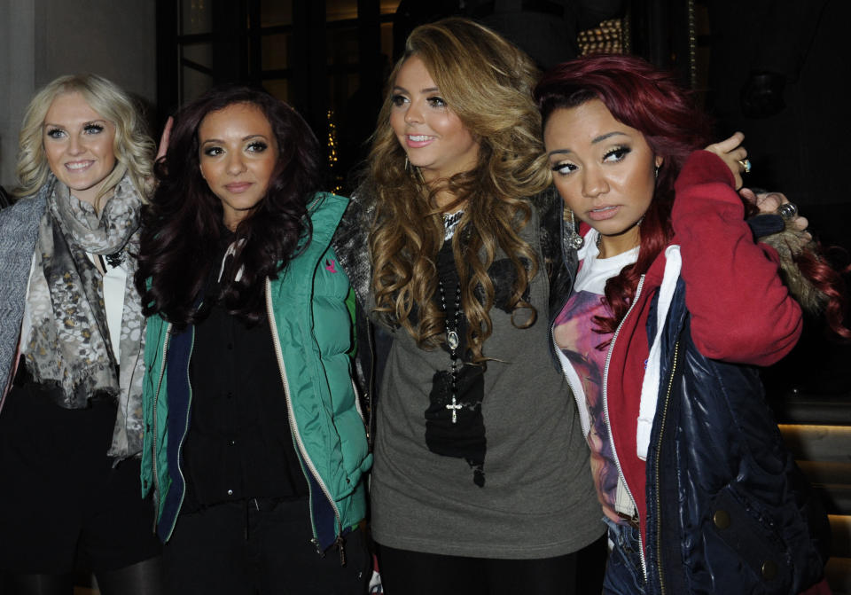 """X Factor winners Little Mix outside the Corinthia Hotel, London. PRESS ASSOCIATION Photo. Picture date: Monday December 12, 2011. The group said they plan to write their own songs and insisted they would not be girl group """"clones"""". The foursome, who were propelled to stardom last night when they won the ITV1 talent show, thanked their fans and said they had """"made our dreams come true"""". See PA story SHOWBIZ XFactor. Photo credit should read: Rebecca Naden/PA Wire"""