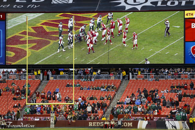 FILE - In this Nov. 17, 2019, file photo, some fans watch during the second half of an NFL football game between the Washington Redskins and the New York Jets, in Landover, Md. There were more than 20,000 empty seats for the Redskins last home game, and when many of them have been filled this season, its with fans of the visiting team. It could be even emptier Sunday when the 1-9 Redskins host the 3-6-1 Detroit Lions. (AP Photo/Patrick Semansky, File)