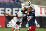 Toronto FC's Omar Gonzalez (44) and New England Revolution's Teal Bunbury (10) vie for a head ball during the second half of an MLS soccer match Wednesday, Oct. 7, 2020, in Foxborough, Mass. (AP Photo/Steven Senne)