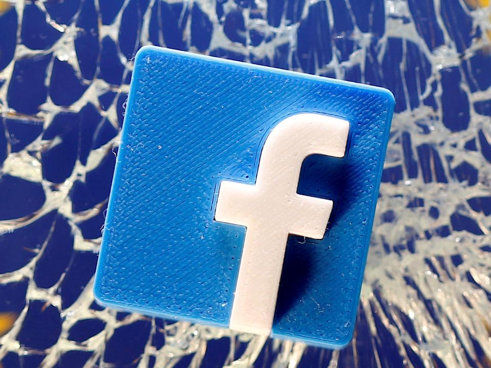 FILE PHOTO: A 3D printed Facebook logo is placed on broken glass above a printed EU flag in this illustration taken January 28, 2019. REUTERS/Dado Ruvic/Illustration/File Photo