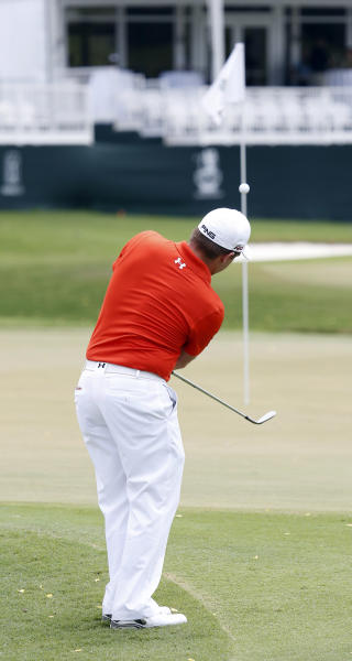 Daniel Summerhays chips to the ninth green during the first round of the Sanderson Farms Championship golf tournament, Thursday, July 18, 2013 in Madison, Miss. (AP Photo/Rogelio V. Solis)