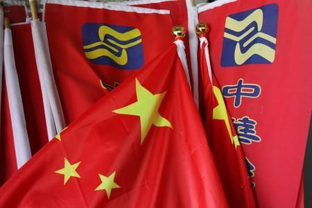 The party flag for the Chinese Unity Promotion Party and China's national flag are seen at Lin Guo-cingÕs office in Tainan