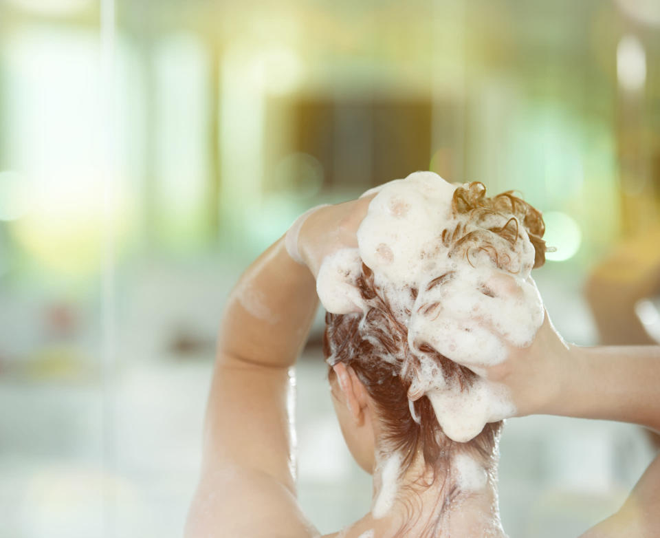 Is it possible to train your hair to need less washing? [Photo: Getty]