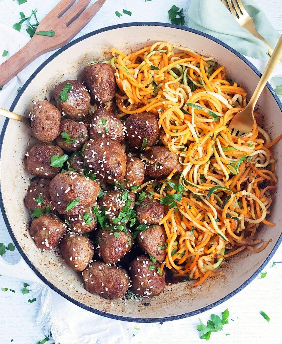 """<p>These meatballs are can't-stop-eating good, but the turkey and the veggie-packed zucchini and squash noodles keep things healthy.</p><p><strong>Get the recipe at <a href=""""https://www.beautifuleatsandthings.com/2020/01/01/garlicky-sesame-turkey-meatballs-with-zucchini-butternut-squash-noodles/"""" rel=""""nofollow noopener"""" target=""""_blank"""" data-ylk=""""slk:Beautiful Eats & Things"""" class=""""link rapid-noclick-resp"""">Beautiful Eats & Things</a>.</strong><strong><br></strong></p><p><strong><a class=""""link rapid-noclick-resp"""" href=""""https://www.amazon.com/Spiralizer-Vegetable-Strongest-Heaviest-Gluten-Free/dp/B00GRIR87M?tag=syn-yahoo-20&ascsubtag=%5Bartid%7C10050.g.31929300%5Bsrc%7Cyahoo-us"""" rel=""""nofollow noopener"""" target=""""_blank"""" data-ylk=""""slk:SHOP SPIRALIZERS"""">SHOP SPIRALIZERS</a><br></strong></p>"""