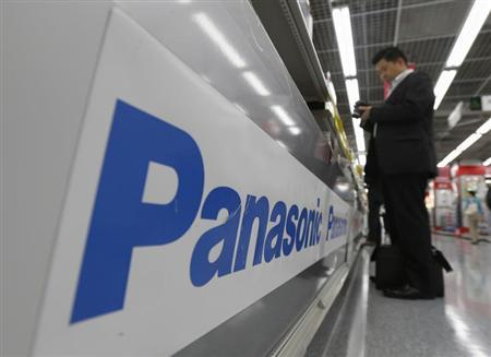 A man browses a Panasonic camera at an electronics shop in Tokyo