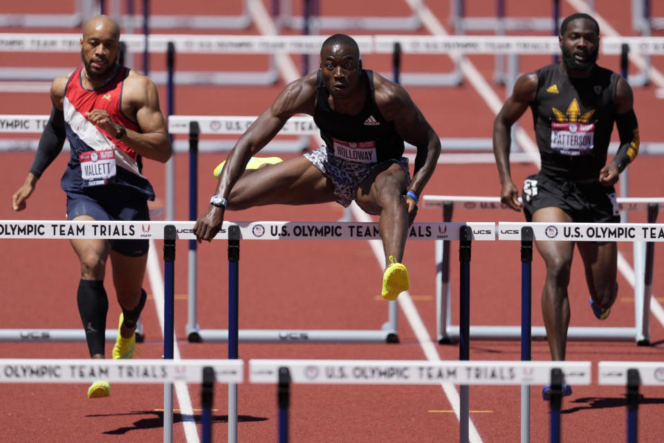 Grant Holloway wins the first heat in the men's 400-meter hurdles at the U.S. Olympic Track and Field Trials Friday, June 25, 2021, in Eugene, Ore. (AP Photo/Ashley Landis)