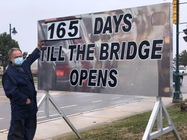 Fen Mabey is counting down the days until a new Petitcodiac River bridge is expected to open. (Gary Moore/CBC - image credit)