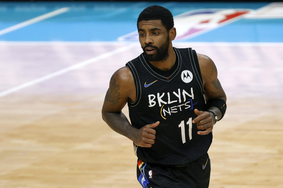 Kyrie Irving #11 of the Brooklyn Nets runs the court during the fourth quarter of their game against the Charlotte Hornets at Spectrum Center on December 27, 2020 in Charlotte, North Carolina