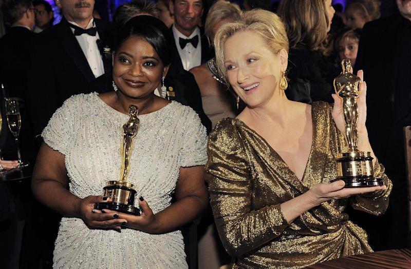 """Octavia Spencer with the Oscar for best actress in a supporting role for """"The Help"""", left, and Meryl Streep with the Oscar for best actress in a leading role for """"The Iron Lady"""" pose at the Governors Ball following the 84th Academy Awards on Sunday, Feb. 26, 2012, in the Hollywood section of Los Angeles. (AP Photo/Chris Pizzello)"""