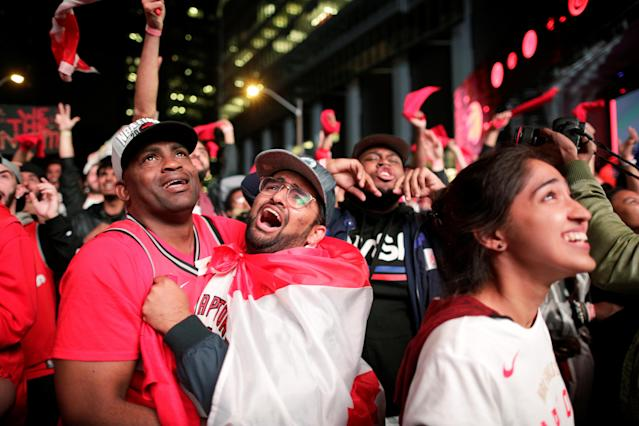 Fans celebrate after the Toronto Raptors defeated the Golden State Warriors in Game Six of the best-of-seven NBA Finals. REUTERS/Andrew Ryan